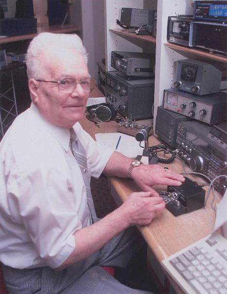 One hundred years after Marconi's first official transatlantic wireless telegraph message, Bill Appleton of Sydney's amateur radio club transmits a commemorative message to Poldhu on December 15, 2002